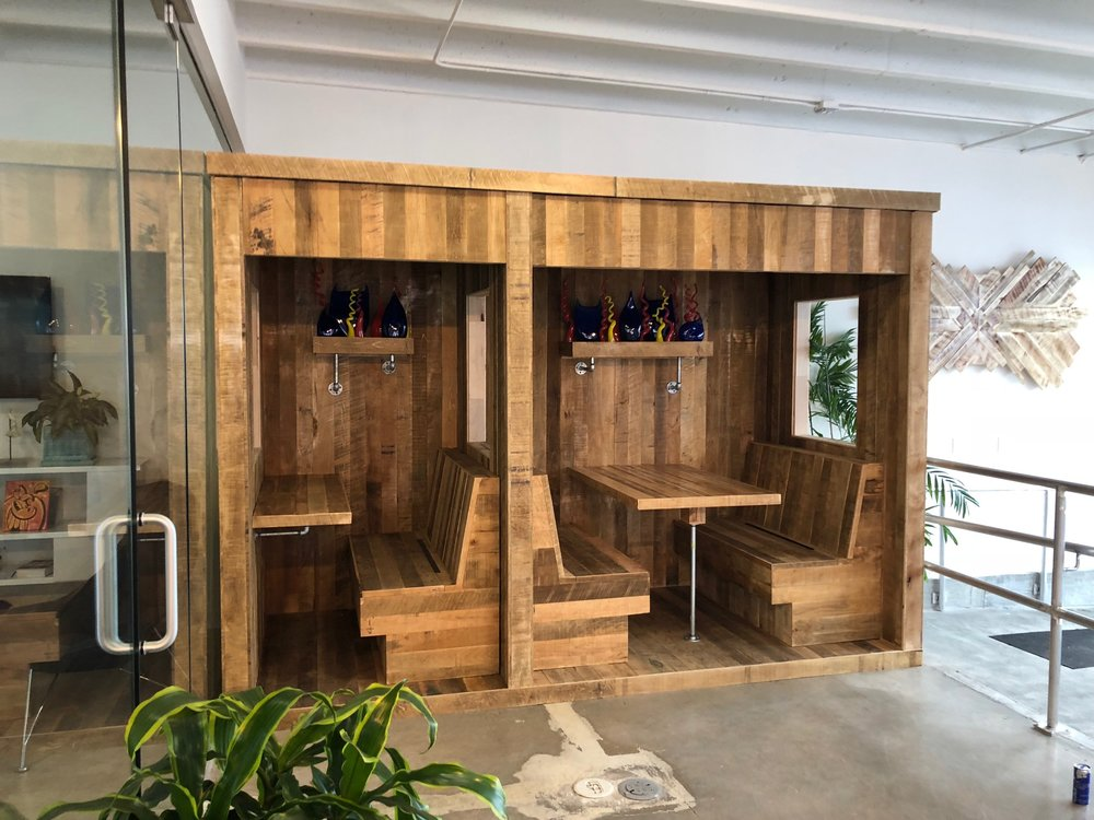 Red Bull Miami office privacy booths and acoustic wood panel decor