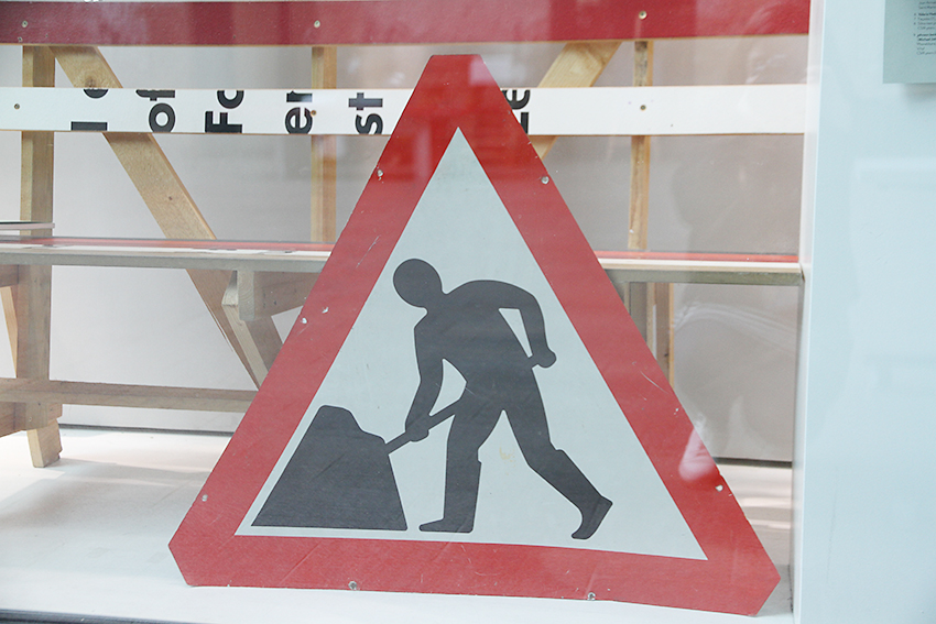 'Men At Work' road sign designed by Kinneir Calvert (1965). Symbol drawn by Margaret Calvert, on display at the A+ exhibition at Central Saint Martins in 2016