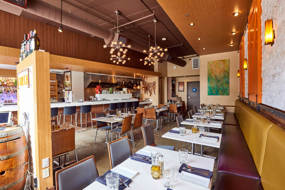 Main Dining - Up to 40 people seated plus 14 bar seating.