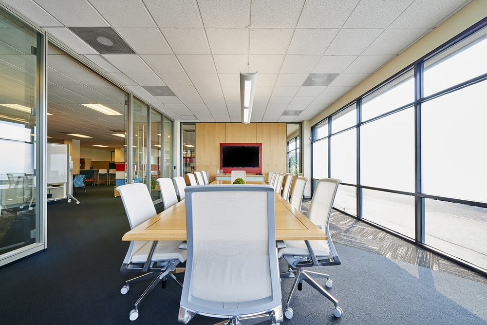 Brightly lit modern conference room with large windows