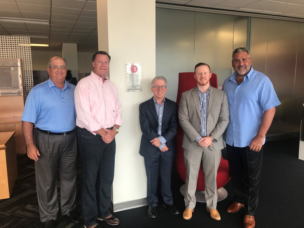 The Haworth and NOI team celebrate in front of the Best In Class 2017 plaque prominently displayed in the NOI showroom. Left to right: John Franklin (Haworth), David Graves (Haworth), Rick Peppers (NOI), Derick Peppers (NOI), Nick Haritos (Haworth).