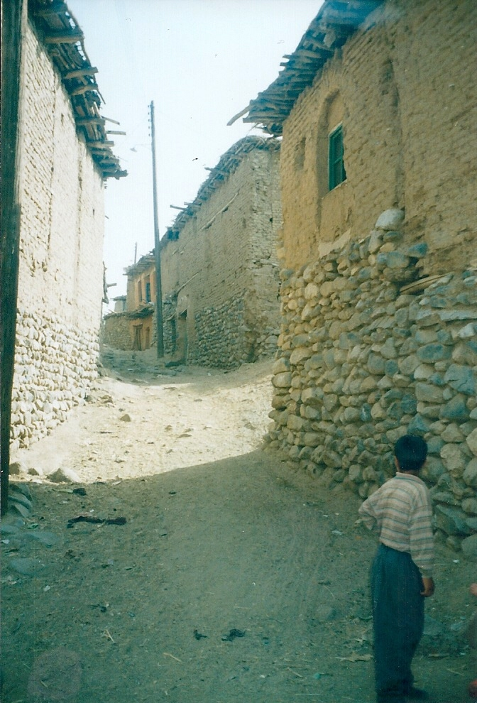 Going through narrow streets of the village to get to the mountain.jpg