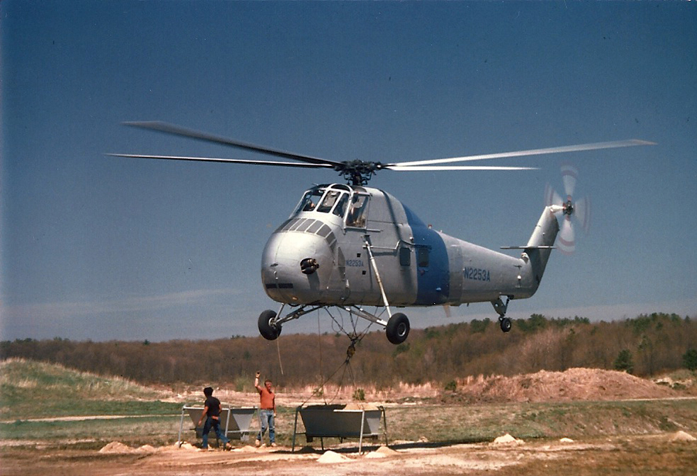 Helicopter Gets Load of Sand | The 14 and 35 acre bogs were in need of a lot of sand; the river kept the ice open, so Tidmarsh resorted to flying sand on with helicopters.