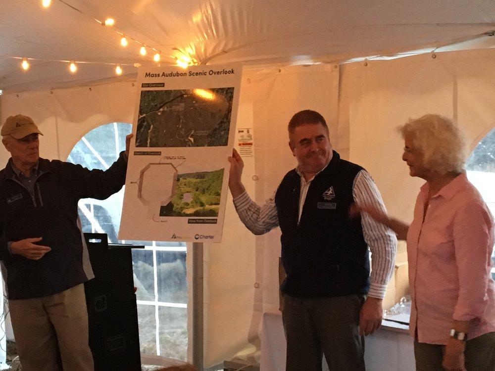 Bob Wilbur accepts image of Tidmarsh before restoration.
