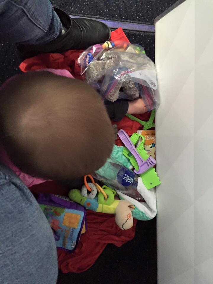 This is my Daughter playing on the floor during our flight from FLorida to Arizona. first class bulk head - delta