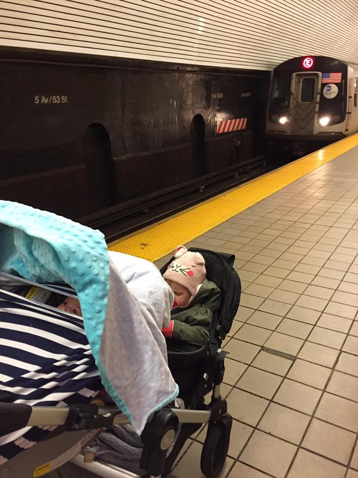 This was my view from the top of my stroller in the subway -- Baby up top, toddler down low