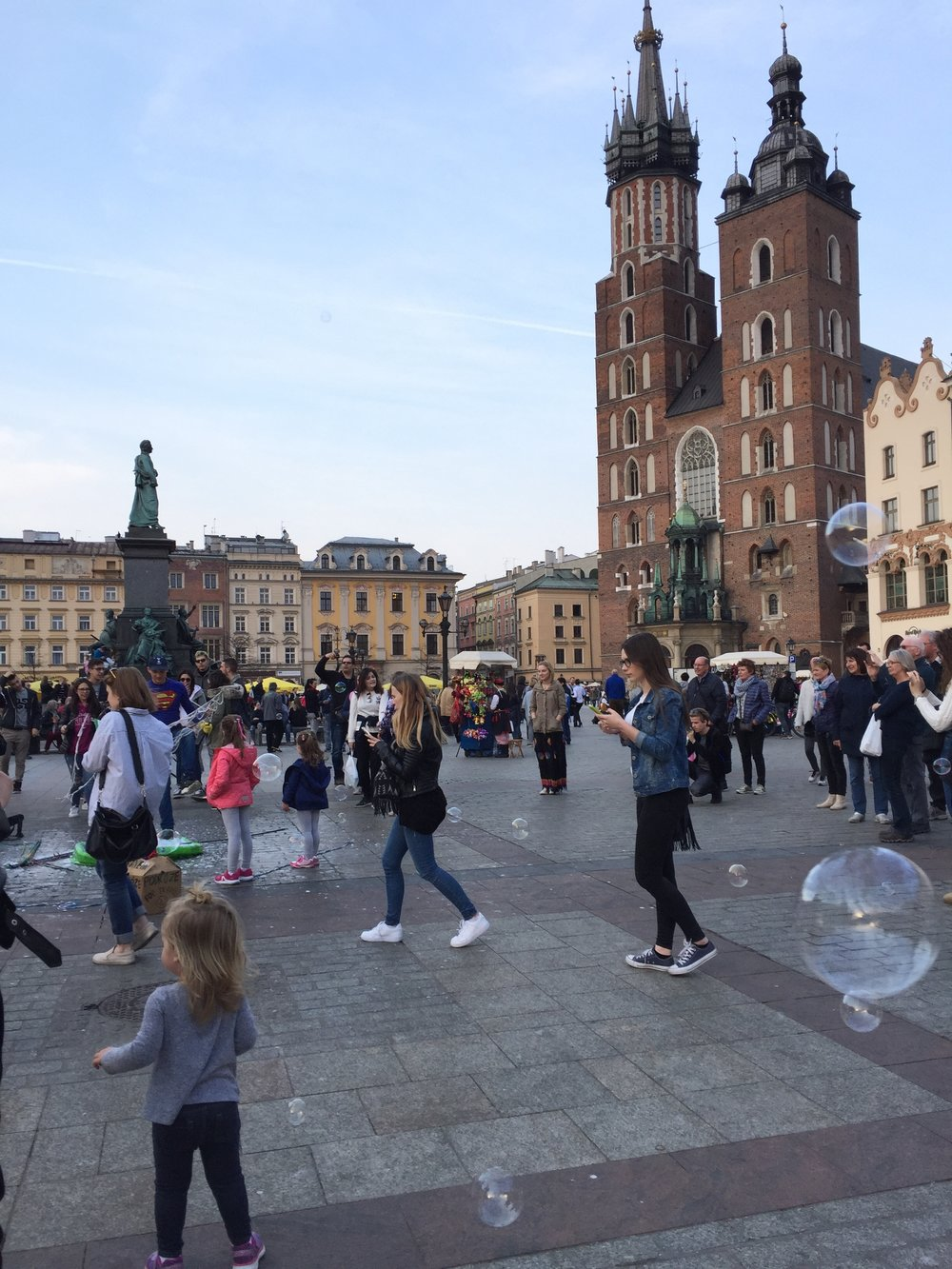 Charletta chasing bubbles in Rynek Glowny (Main Market Square)