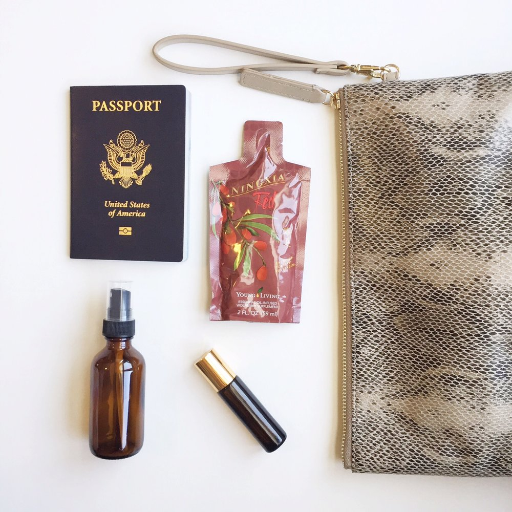 Essential Oils for Travel: Passport with Ningxia Red, a purse, a roller & Spray Bottle
