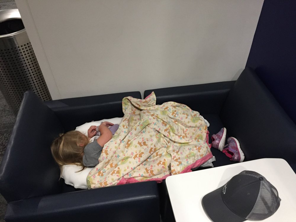 OUr daughter, age 2 here, is sleeping in two chairs we pulled together in a delta lounge in atlanta