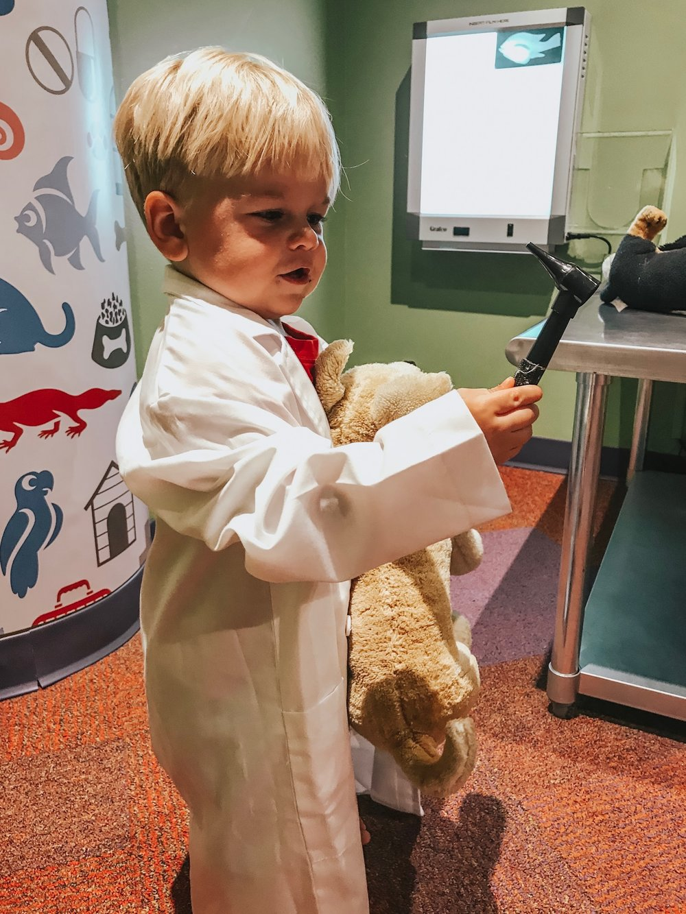 Latham acting as a veterinarian at the Museum of Discovery