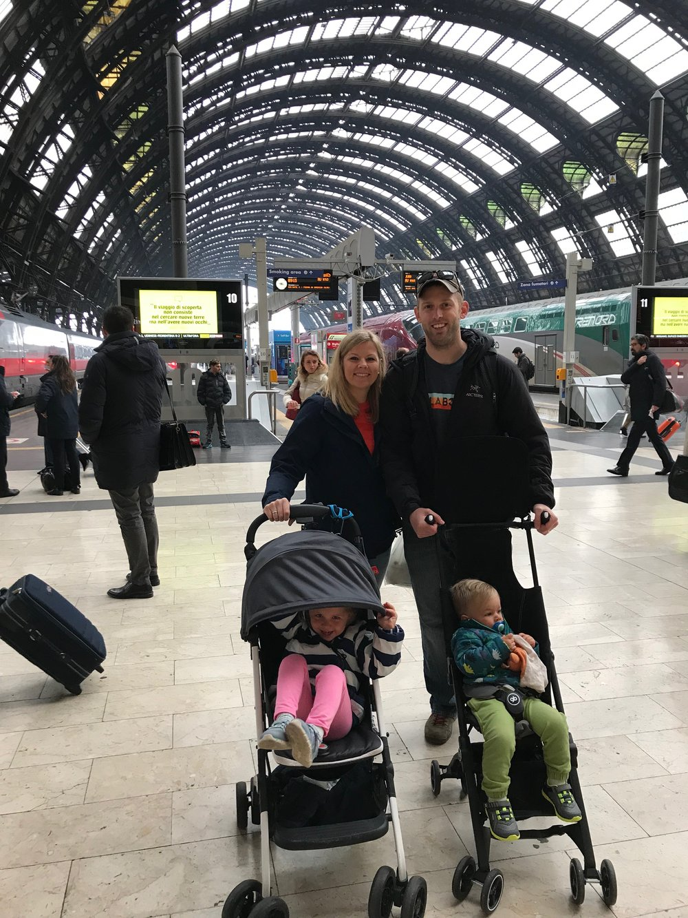 The toddlers and us in the Milan train station before we day tripped over to Turin