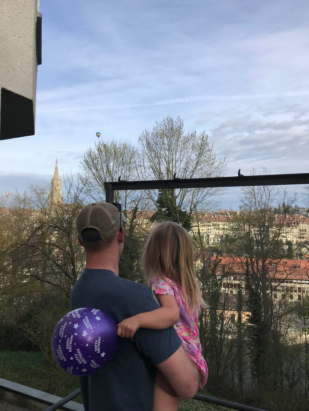 charletta turned three while we were in bern.  The hosts brought her a cake and balloons to celebrate.  This is  the view from our airbnb the morning of her birthday and hot airballoons were flying over!
