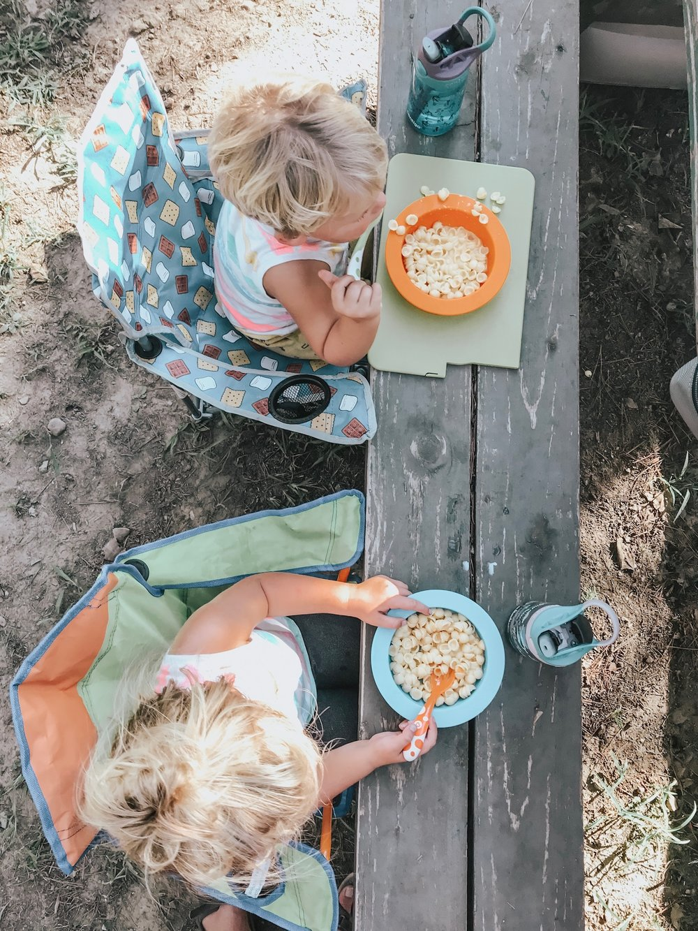Here are the kiddies with their toddler camping chairs eating mac-n-cheese