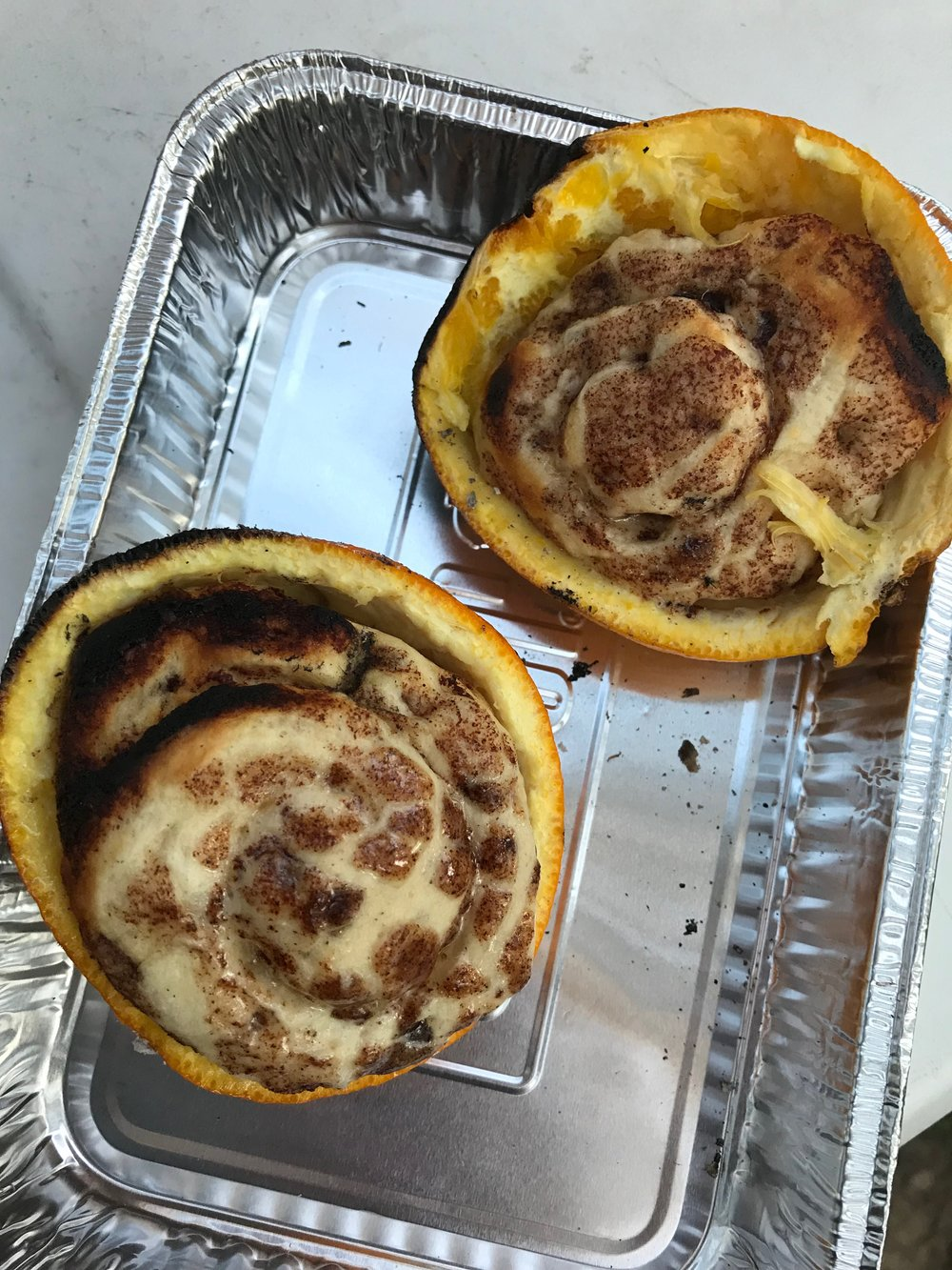 Cinnamon Rolls cooked directly on the fire in Orange Peels - SO GOOD