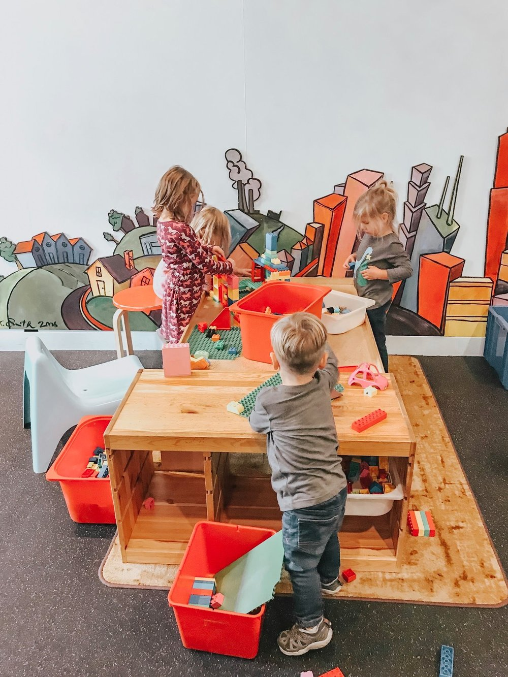 The kids playing in the Building Zone Exhibit