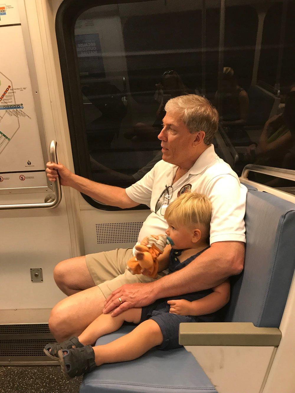 Latham riding the metro with his grandpa, pop pop