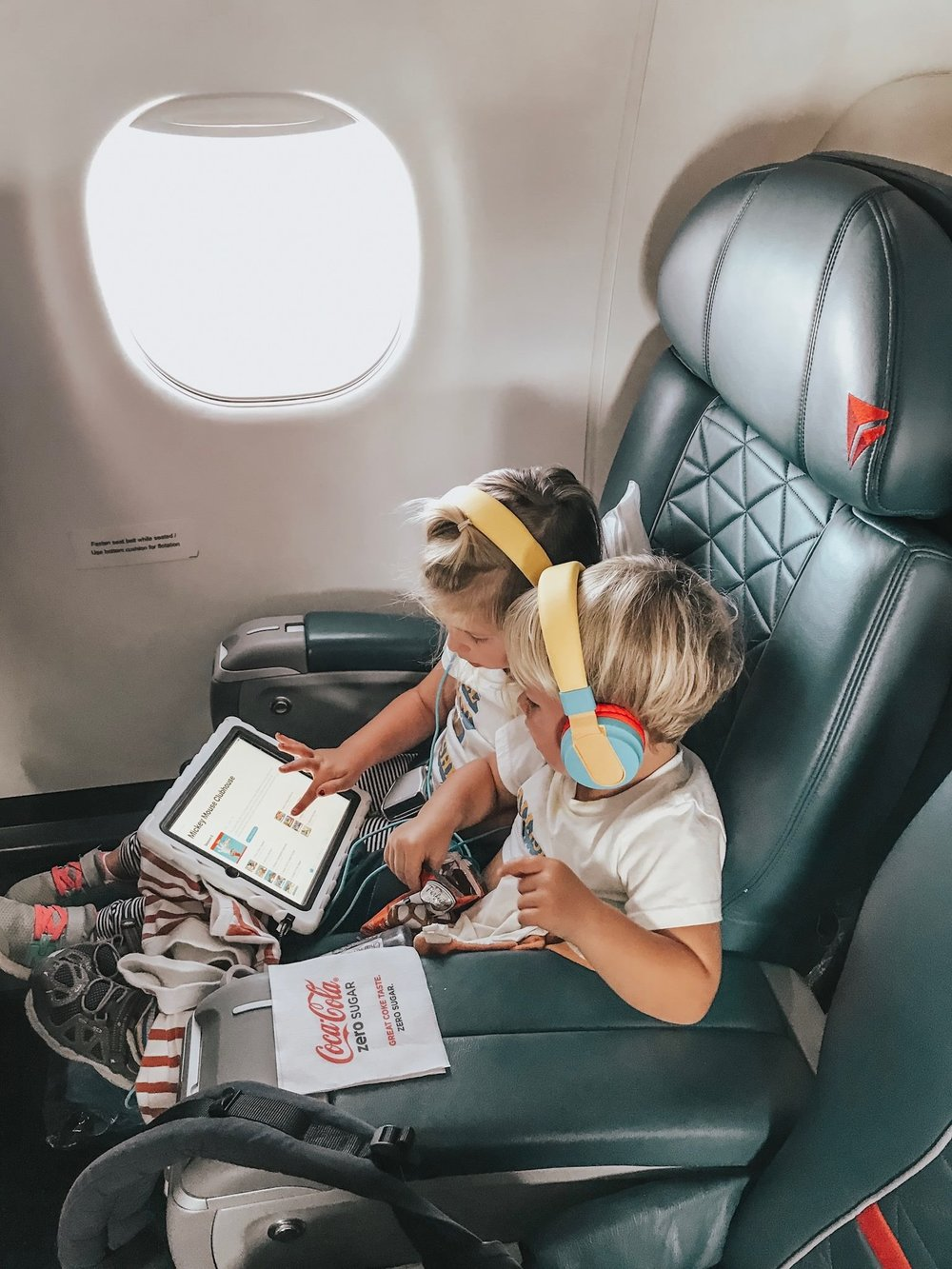 The kids playing on their iPad