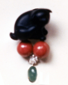 #85 EBONY DOG NETSUKE_ emerald, coral, diamonds .jpg