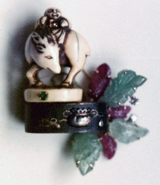 #128 MAN RIDING WATER BUFFALO NETSUKE ON FUCHI_ carved rubies, emeralds, emerald .jpg