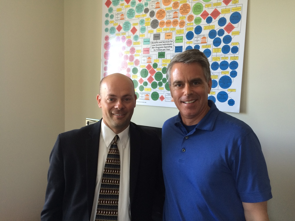 Tim Becker, Chief Deputy Director at the Michigan Department of Health and Human Services, and Michael Brennan, CEO of Civilla, at the MDHHS headquarters in Lansing.