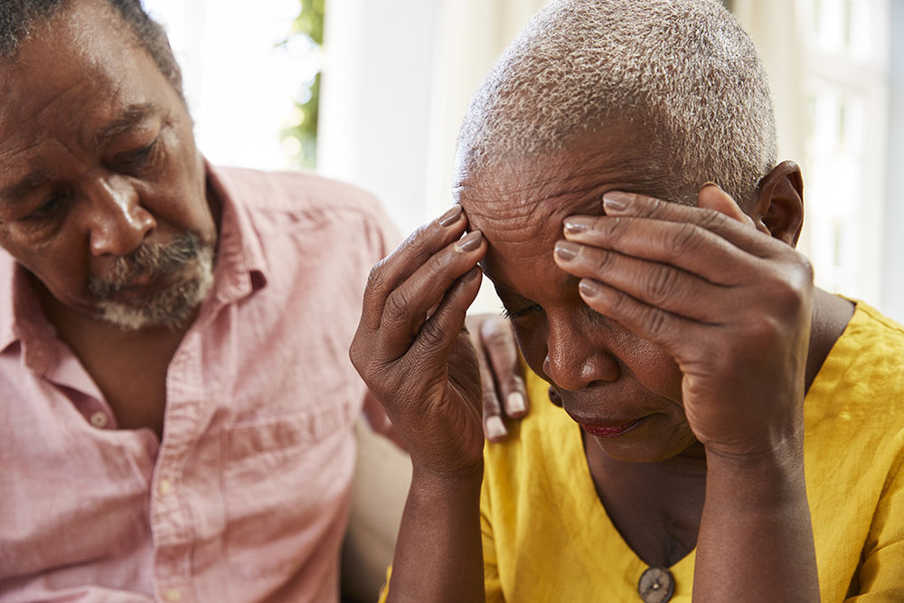 sad-elderly-black-woman-and-man.jpg