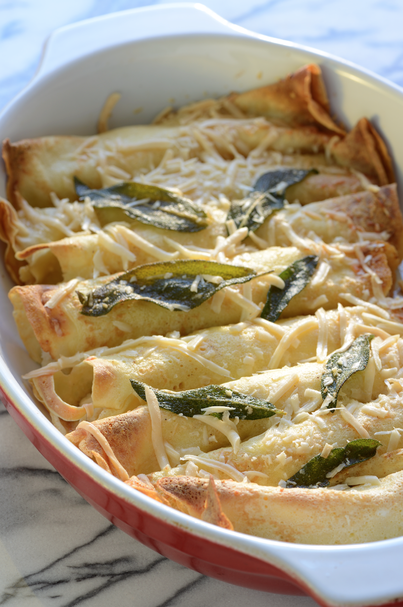 These crepes are filled with ricotta and melted butter flavored by sage leaves and topped with Parmesan. Heavenly! One of many ideas for filling.Photo by  Ann Cutting