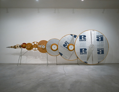 Tim Hawkinson, Spin Sink (1 Rev./100 Years) (1995) Gears, metal, plywood, foam, plastic, corduroy, toy motor.