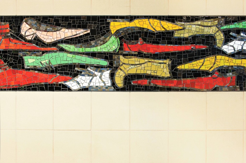 Made of smalti and cake glass, the 2 foot by 115 foot mosaic band wraps across three walls at the station mezzanine entry and was created by artisans at the Miotto Mosaic Art Studio in Carmel, NY.