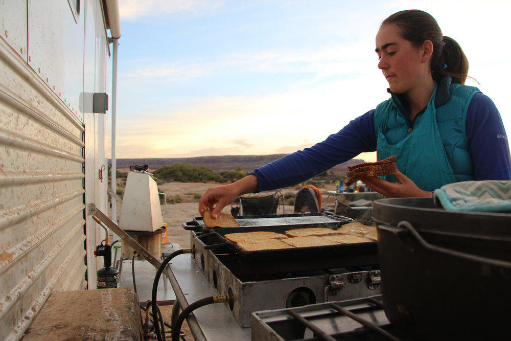 Sarah cooks up french toast on Comb Ridge