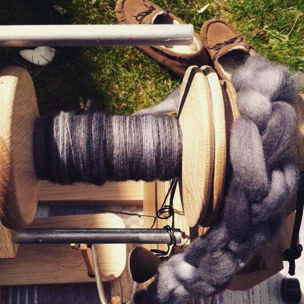 Spinning   Malabrigo   fiber in my beautiful front yard