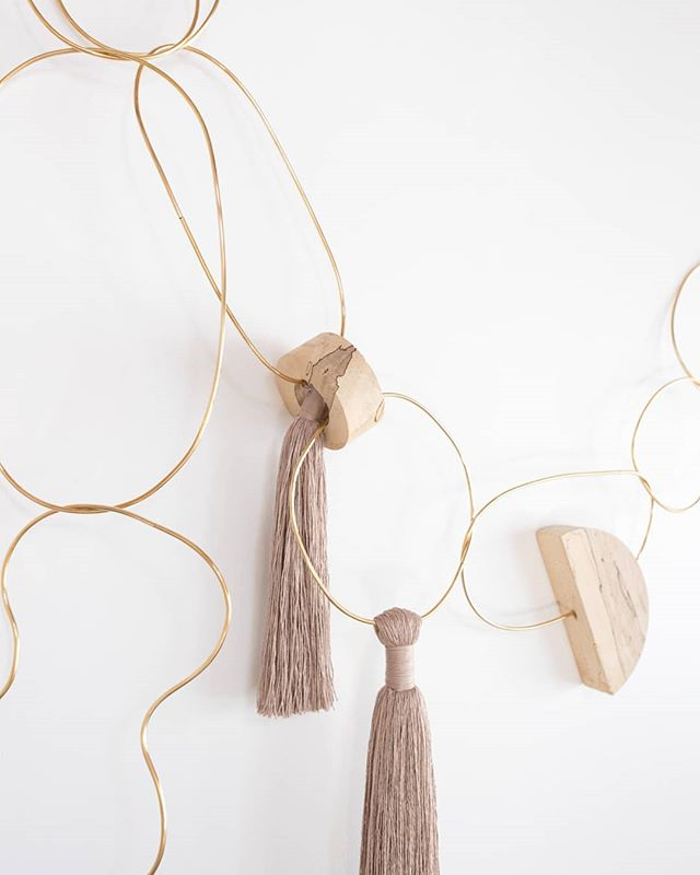 Chain link details. Made with brass, spalted maple, and natural fibers