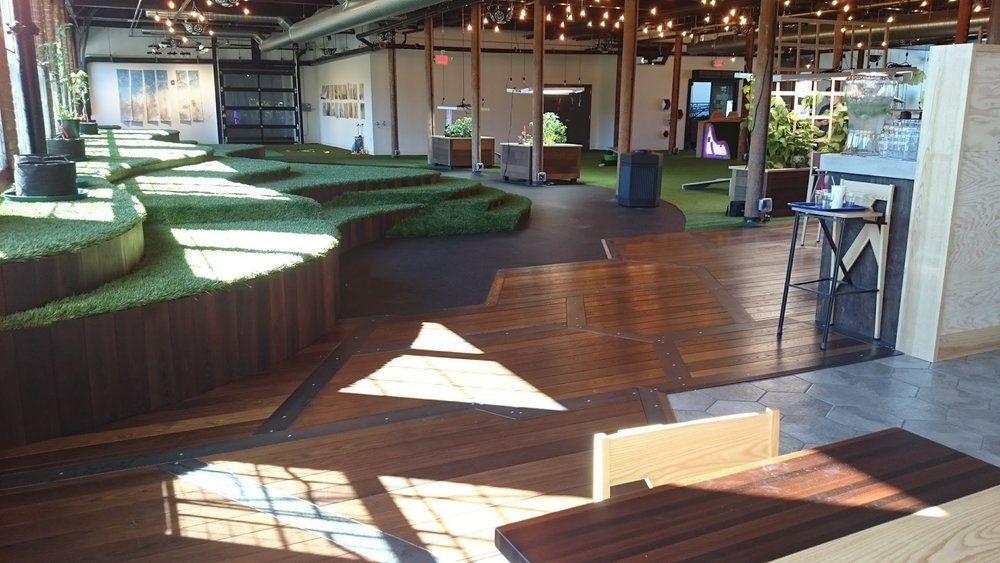 This restaurant in America includes the outside inside. The restaurant is surrounded by snow in winter, so what a great place to take the family in winter. This feels like you are in the garden with the synthetic grass. This child friendly space gives a great indoor space in winter.  Synthetic grass is great for creating a green play area inside or out.(works by others)