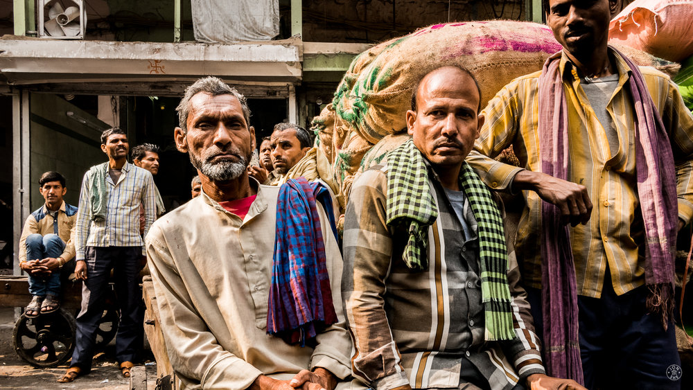 """Men and their Scarves"".  Old Delhi, India. January 2017. © Jon She. Leica M10, Leica Summilux 28mm f/1.4 ASPH. A team of sartorially elegant resting laborers at the Spice Market in Delhi."