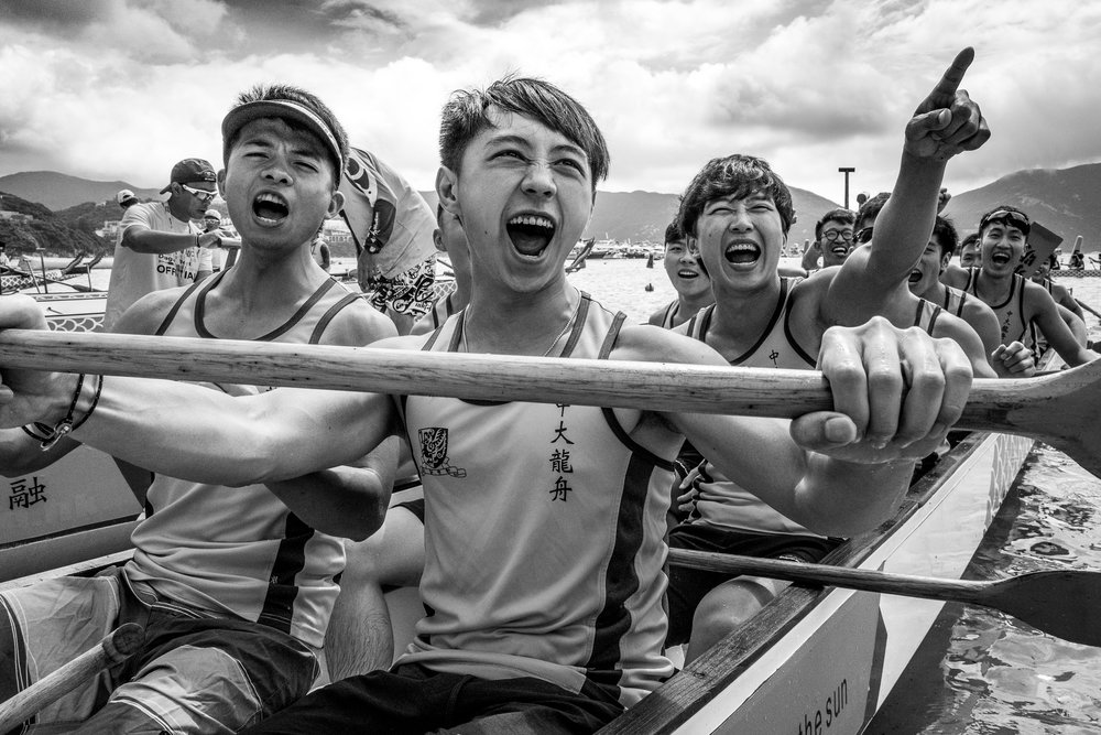 """Team Spirit"".  A Dragonboat Festival Race team from Hong Kong University doing what they do best. Hong Kong, China. June, 2016. © Jon She. Leica Q (Typ 116), Leica Summilux-M 28mm ASPH."