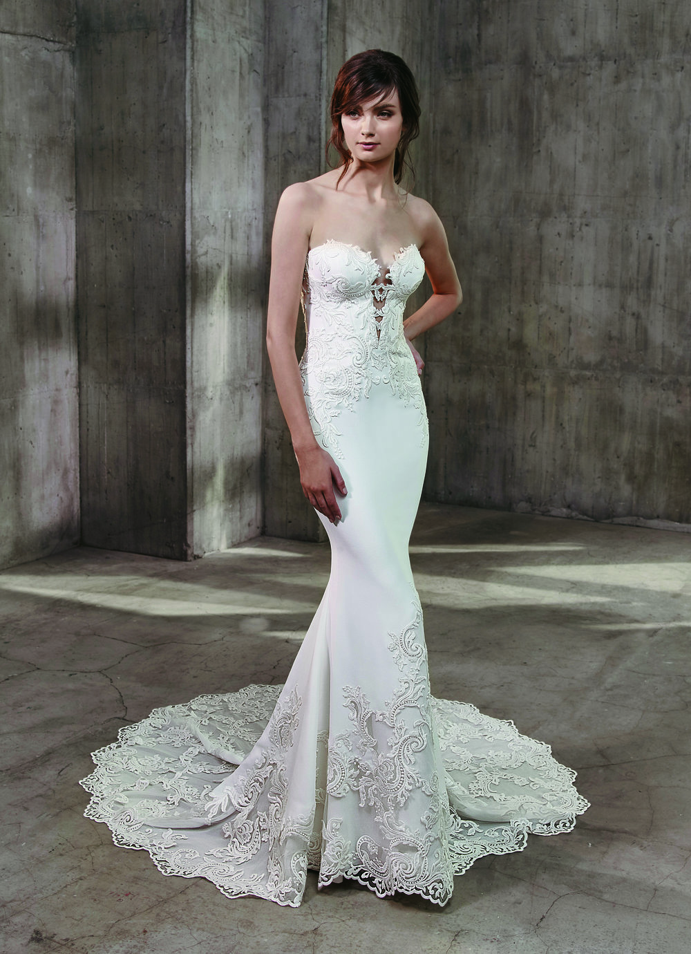 Sophisticated, sexy, and unquestionably stunning, this full-length Badgley Mischka mermaid gown is our dress of the month! Showcasing the softest, sleekest stretch crepe fabric adorned with gorgeously ornate lace embroidery give this dress serious wow factor.