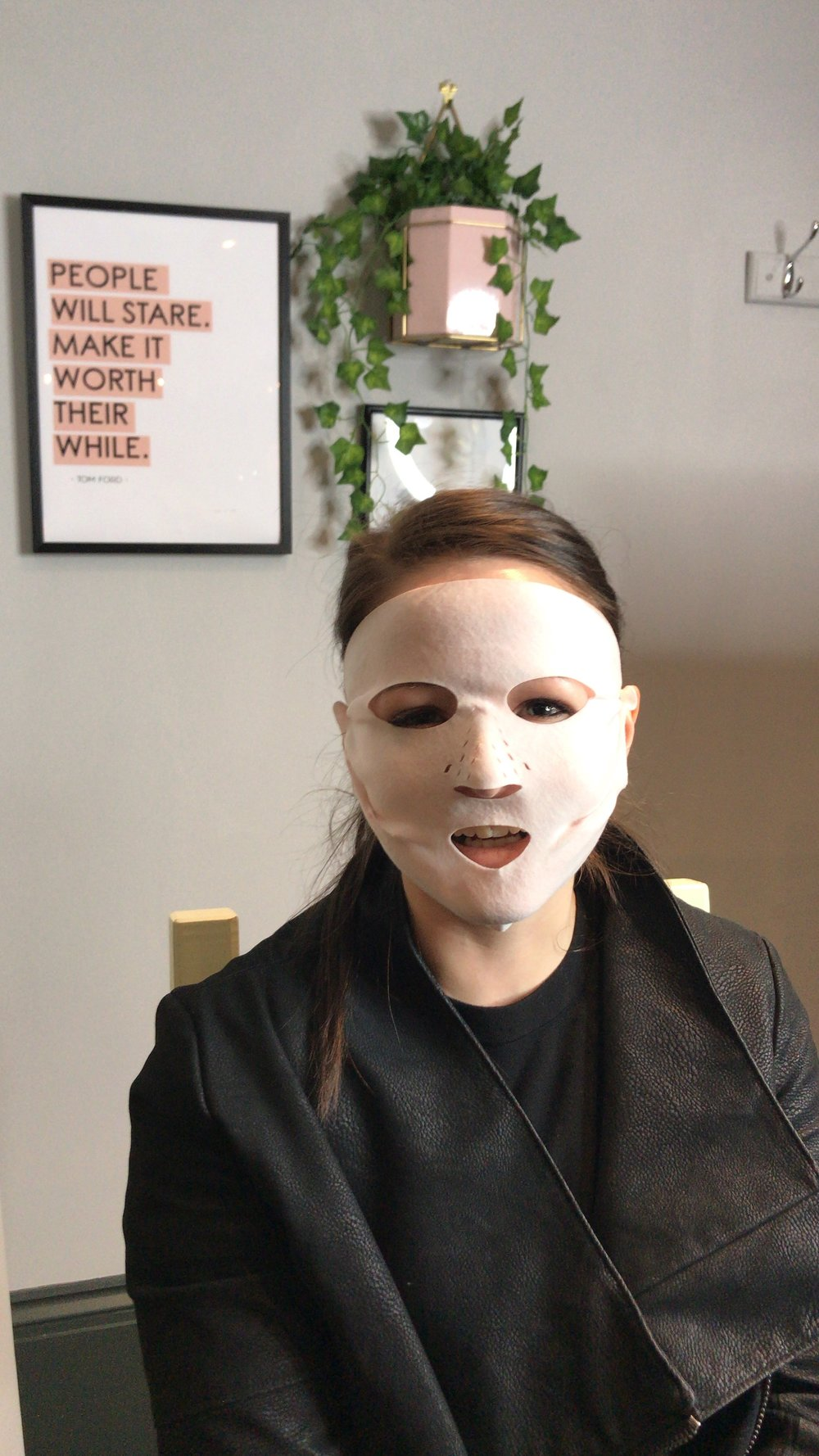 Kendra prepping for her makeover by wearing the Charlotte Tilbury dry sheet mask - which is basically a mini facial.