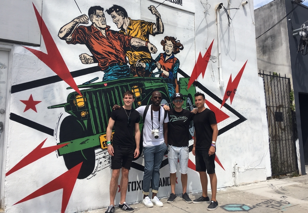 Host Will Best strikes a pose with Black Coffee in the Wynwood District of Miami alongside Producer Pete Madigan and Director Alejandro Reyes-Kinight