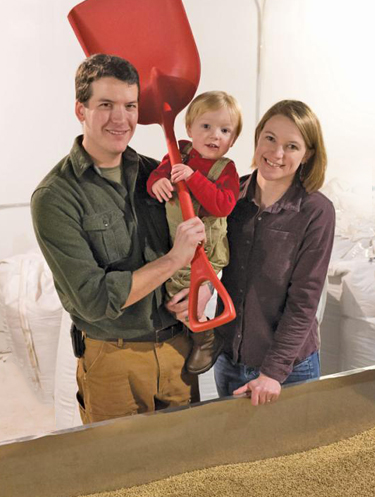 Zach and Megan Goldenberg, owners of Macon Creek Malt House, with their son Reuben Dean.