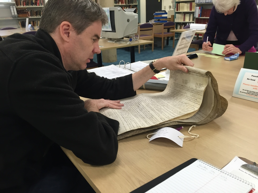 Reviewing a 1614 manorial court roll for the parish of Fenstanton, at the Huntingdon Archives. This document was found to contain a reference to Henry Howland, the father of  Mayflower  passenger John Howland--a small fine for bringing a horse exhibiting signs of mange to the manor's common field. Photograph by   Mayflower  historian Caleb Johnson , and research commissioned by the  Pilgrim John Howland Society .