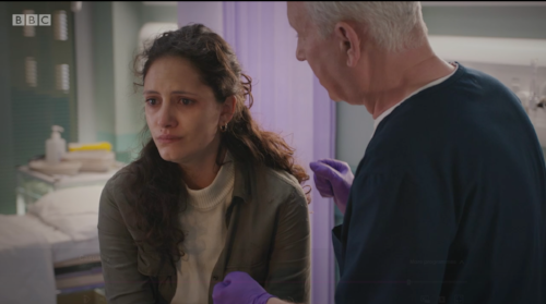 still from CASUALTY, Skye Hallam and Derek Thompson who plays Charlie
