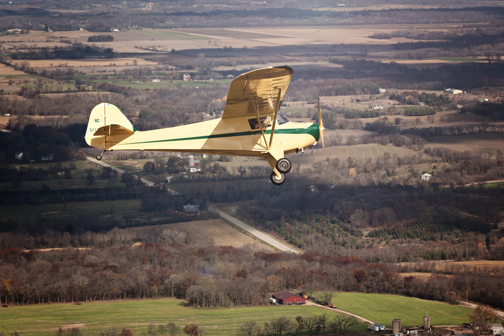 An image of the inaugural flight of the restored 1946 Taylorcraft BC12D.