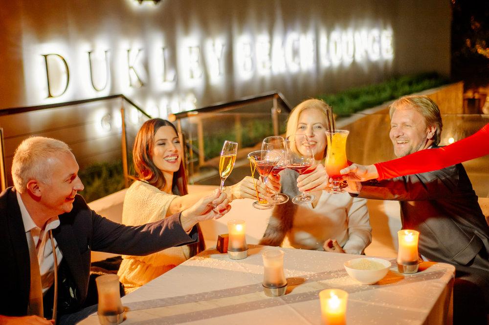 Отель Dukley Hotel & Resort расположен на первой пляжной линии в туристической столице Черногории в городе Будва, с собственным причалом для яхт и является образцом современного стиля жизни. Неподалеку расположена Dukley Marina - пристань из 300 причалов, предлагающая полный комплекс услуг владельцам яхт. Из окон роскошных апартаментов отеля открывается чарующие виды на кристально-чистое Адриатическое море и остров Святого Николая и в тоже время отель огражден от праздных посетителей и гарантирует своим жильцам уединенность и спокойствие. Все апартаменты оформлены в уникальном стиле и оснащены современными удобствами для спокойного комфортного отдыха. К услугам гостей отеля собственные песчаные пляжи и пляжные бары, а также роскошный ресторан высокой кухни - Dukley Beach Lounge, бесплатная парковка, трансфер от и до аэропорта Тиват, спи и тренажерный зал, лодка, следующая в Старый город Будвы. Для осмотра окрестностей гости отеля могут воспользоваться гольф-мобилем. Развитая инфраструктура, которая позволяет легко решать бытовые задачи, вести здоровый образ жизни, заниматься хобби и находить идеи для отдыха и развлечений. В числе удобств всех апартаментов - меблированная терраса, кондиционер, система Умный дом и бесплатный Wi-Fi. В распоряжении проживающих находится команда консьержей, работающая круглосуточно, которая готова выполнить любой запрос. В распоряжении гостей каждых апартаментов полностью оборудованная кухня с обеденной зоной, гостиный уголок, оснащенный телевизором с плоским экраном, транслирующим кабельные каналы, в том числе российское телевидение, а также просторная собственная ванная комната с халатами, тапочками и бесплатными туалетно-косметическими принадлежностями. В отеле имеется великолепный, современный и изысканный ресторан Dukley Beach Lounge, где можно отведать фирменные блюда средиземноморской и интернациональной кухни или заказать напиток . Только свежие местные продукты используются для приготовления блюд.