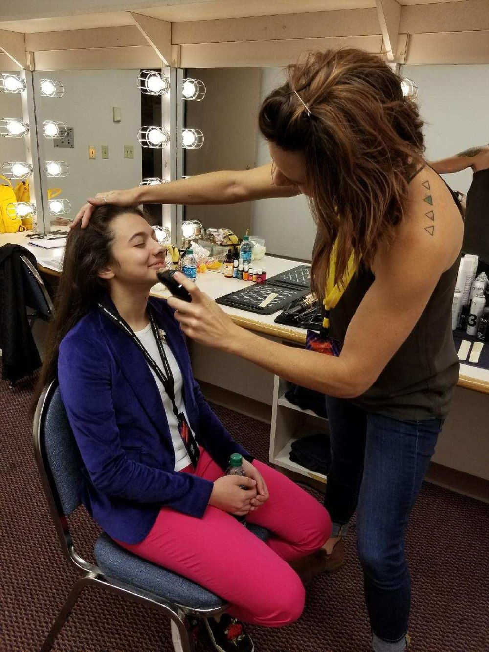 Airbrushing Laura Bretan before a preformance.