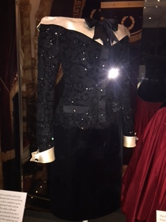 Interest at the shoulders;fitted to below the waist; straight skirt in a different fabric.