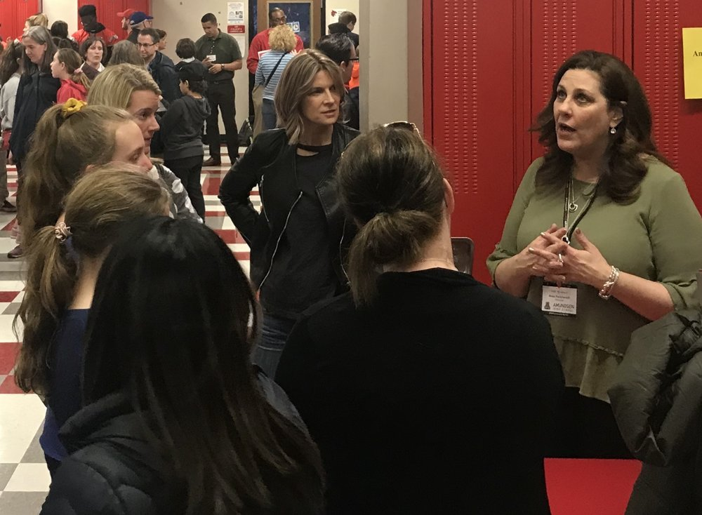 amundsen principal anna Pavichevich chatting with parents
