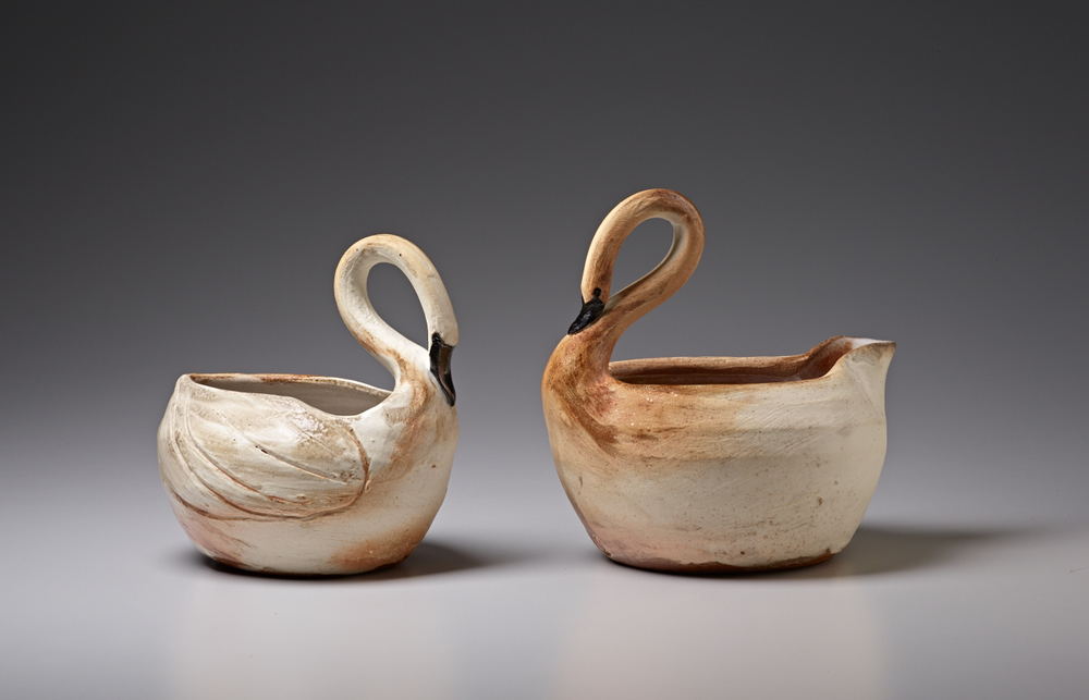 "Mary Law, Swan Vase, 5""H, and Swan Gravy Boat, 6""H, wheel thrown stoneware, soda fired. Photo: M. Lee Fatherree"