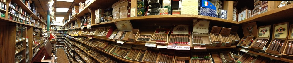 collection of cigars, tobacco pipes and accessories