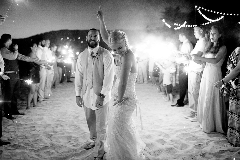 """We got Jolynne to be our wedding photographer! This calls for sparklers and dancing!"""