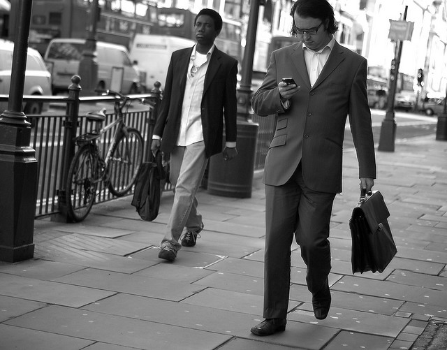 businessman checking email while walking