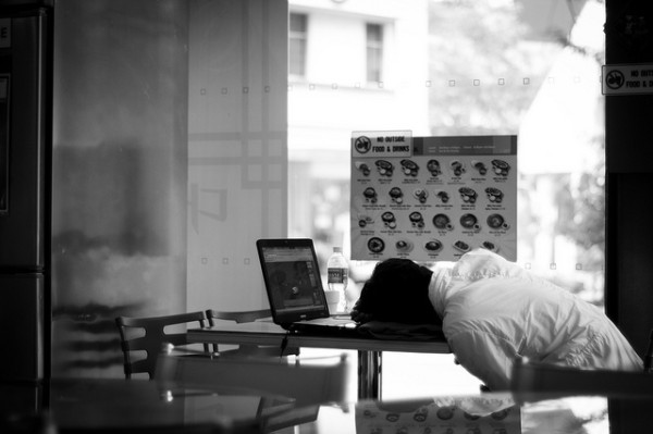 worker asleep at desk